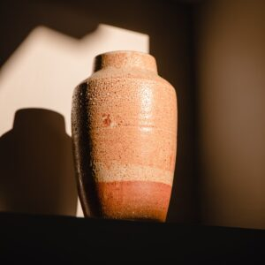 An urn sitting in the sunlight.