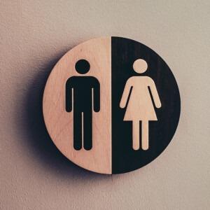 Símbolos de género en una placa redonda.