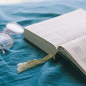 Bible and glasses.