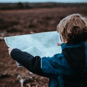 kid reading a map