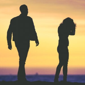 silhouette couple in front of sunset
