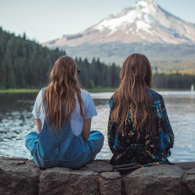 Photo of two woment looking toward a mountain by Roberto Nickson on Unsplash