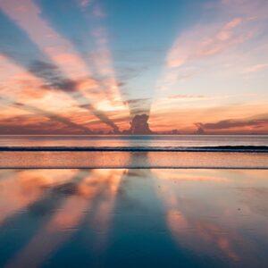 An image of a sunrise over a beach.