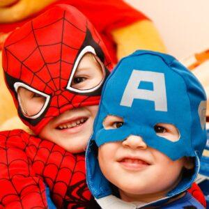 Two boys dressed like super hero's.