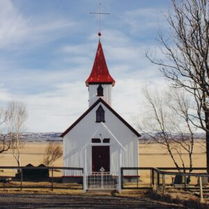 A small white church building.