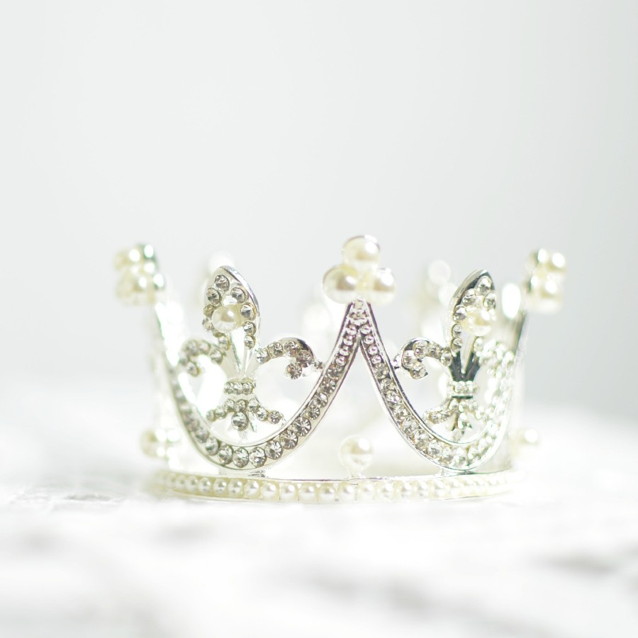a crown with diamonds and pearls