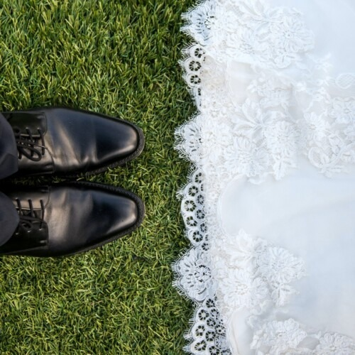 groom shoes and white wedding dress