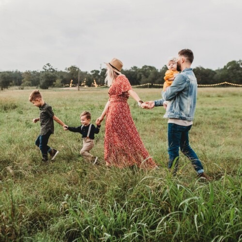family of five walking in a field