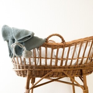 baby basket with clothes on top