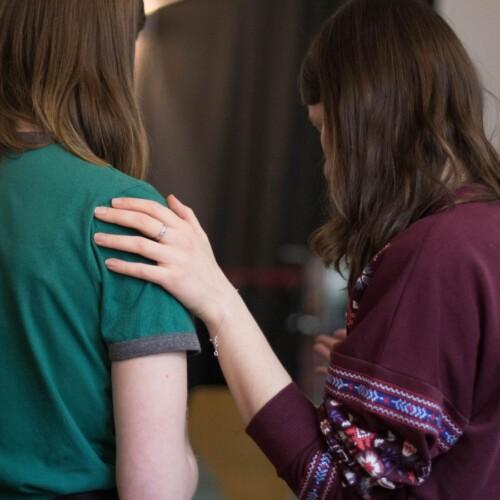 two girls praying together