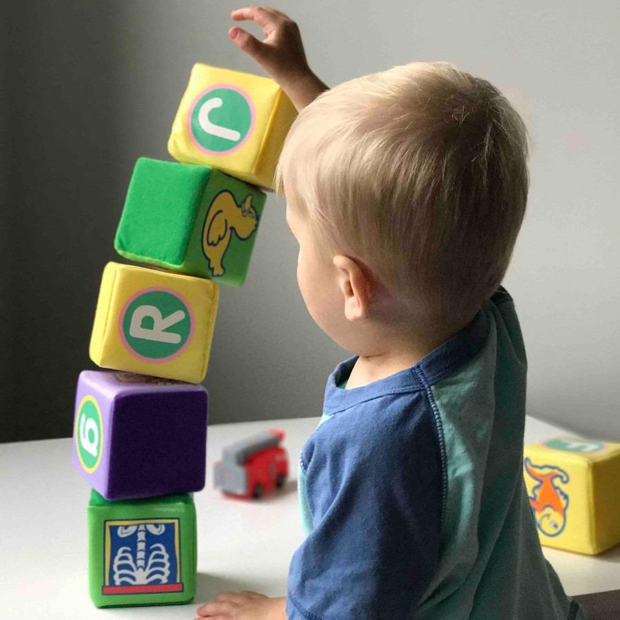 little boy building with blocks