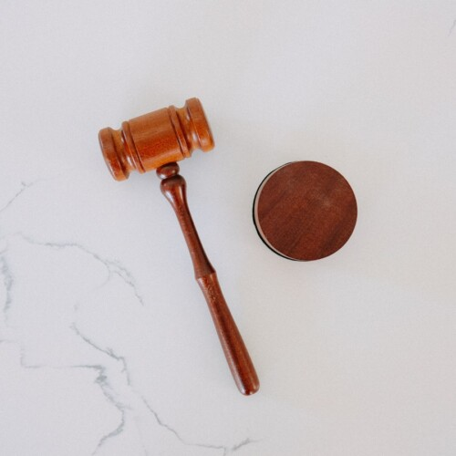 wooden gavel on white marbel