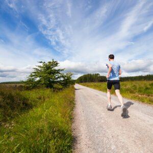 A man running down a dirt road.